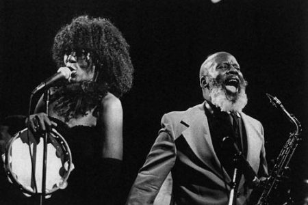 black and white photo of Battiste and Tami Lynn performing on stage