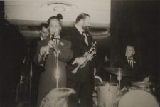 Al Hirt (trumpet) with band on bandstand