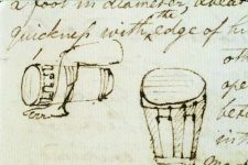 A sketch of one drum seen head on, and another on its side, with the leg of its player on top