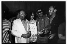 Ahmet Ertegun (1923-2006), Professor Longhair (1918-1980), and George Porter, Jr. (b. 1947) at a party at Sea-Saint Recording Studio. According to the photographer's note, Earl King, Roosevelt Sykes, Eric Clapton, and Bo Dollis were also in attendance.