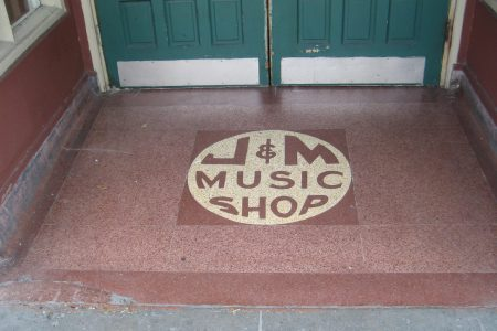 Though the space is now a Laundromat, the entrance to J&M Music Shop and Studio remains.