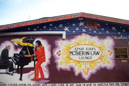Artist Daniel Fuselier painted several murals on the Lounge, each covering his previous work. This iteration depicts K-Doe's collaboration with Allen Toussaint, who wrote the hit that gave the Lounge its name.