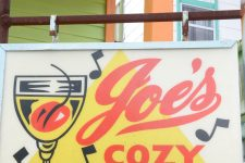 The sign that once hung on Joe's Cozy Corner has migrated into the Bywater, where it adorned a front yard in 2012.