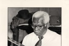 Narvin Kimball playing the banjo. He was a founding member of the Preservation Hall Jazz Band.