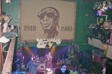 The stage at Tipitina's seen from the balcony in 2004 before a concert by Dr. John. The image on the wall is of Professor Longhair.