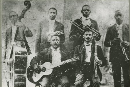 "The only known photograph of Charles ""Buddy"" Bolden. He is standing next to the string bass."