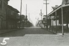 Looking up Bienville Street from Basin Street, toward the lake. Lulu White's saloon and Frank Early's My Place Saloon on the left. Turk's Cafe on the right.