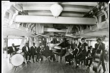 Armstrong with Fate Marable's band, which played on riverboats on the Mississippi.