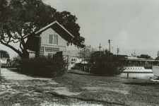 A corner of West End. The white building peeking through the trees is Bruning's Restaurant.
