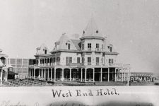 West End Hotel with chairs for the bandstand set up to the left.