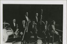 "King Oliver's Creole Jazz Band in 1923: Warren ""Baby"" Dodds, Honore Dutrey, Bill Johnson, Louis Armstrong, Johnny Dodds, Lillian Hardin, and Joe ""King"" Oliver."