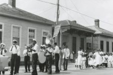 From 1958, Doc Paulin's Brass Band marching in an uptown Sunday school parade, with bandleader Ernest