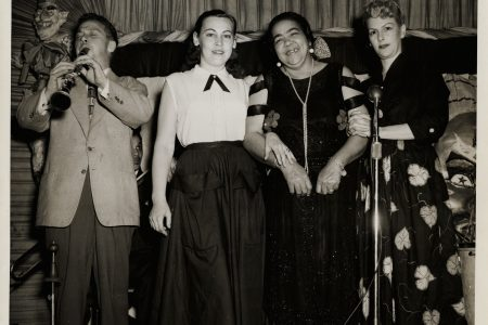 Sid Davilla, Mrs. Peggy Vagabond, Lizzie Miles, and Mrs. Sid Davilla pictured at the Mardi Gras Lounge, date unknown.