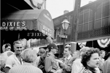 Outside Dixie's Bar of Music on Mardi Gras, ca. 1952-55. Jack Robinson, the photographer, documented his community of artists and bohemians here before becoming a celebrated fashion photographer in New York.