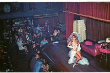 A postcard image from the Sho Bar dated 1972 featuring Brigette Boudreaux and a well-dressed, mixed-gender crowd.