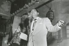 Leon Prima singing at his nightclub, the 500 Club on Bourbon Street, 1950.