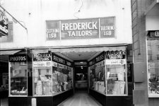 Frederick Tailors and Lincoln Studios, a photographic studio catering to African-American clients, circa 1955. They were a few doors up from Morris Music House.