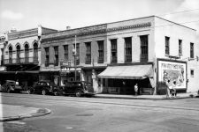 Storefronts across South Rampart Street from McDonogh No. 35 High School in 1942.