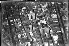 From circa 1922, an aerial view of Canal Street to Poydras Street and Camp Street to South Rampart Street.