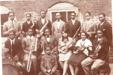 The Mcdonough 35 school orchestra from 1927-1928, under Osceola Blanchet (at right).