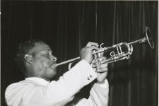 John 'Pickey' Brunious playing trumpet with Paul Barbarin's band at the Dream Room in 1958. Later in life, Brunious would lead the Preservation Hall Jazz Band.