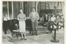 Louis Prima (center) flanked by Keely Smith (left) and Sam Butera (right, with saxophone) on a movie set. Their show in Las Vegas, shaped by Prima's and Butera's upbringings in New Orleans, was a national sensation.