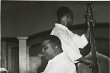 From 1958, Dave Wins at the piano and McNeal Breaux on bass rehearse at the Autocrat Club.