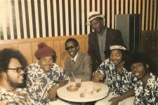 The great vocalist Johnny Adams (seated, middle) flanked by his band after a show.