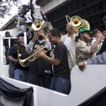The Stooges Brass Band plays on a float in the Undefeated Divas & Gents Social Aid and Pleasure Club second line in 2010.