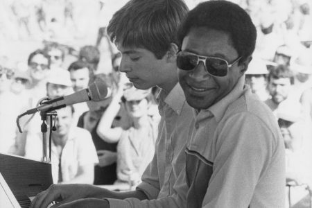 Jesuit alumnus Harry Connick, Jr. on stage with one of his piano teachers, the virtuoso James Booker.