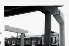 An obsolete sign for the Specialty Records (at right) behind newly constructed pillars for the North Claiborne overpass in 1967, years after the branch office closed.