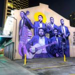 "Mural of Buddy Bolden and band painted in 2018 by Brandan ""BMike"" Odums seen here in 2019."
