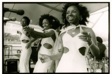 The Dixie Cups performing in 1977: Rosa Lee Hawkins, Joanne Kenney, and Barbara Hawkins.