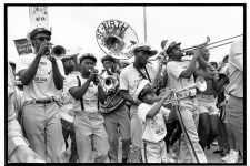 The Rebirth Brass Band (then known as the Re-Birth Jazz Band) playing at Jazz Fest at the Fair Grounds in 1988. Left to right: Kermit Ruffins, trumpet; Philip Frazier, tuba; John Gilbert, saxophone, Derek Shezbie, trumpet.
