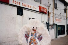 Elisha Barnes of the Creole Wild West Mardi Gras Indians in front of the Rose Tavern on Dorgenois Street near the Calliope Public Housing Development in 1996.